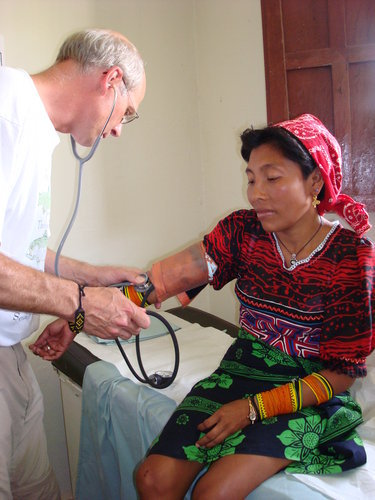 Medical Professional Serving a Kuna Woman